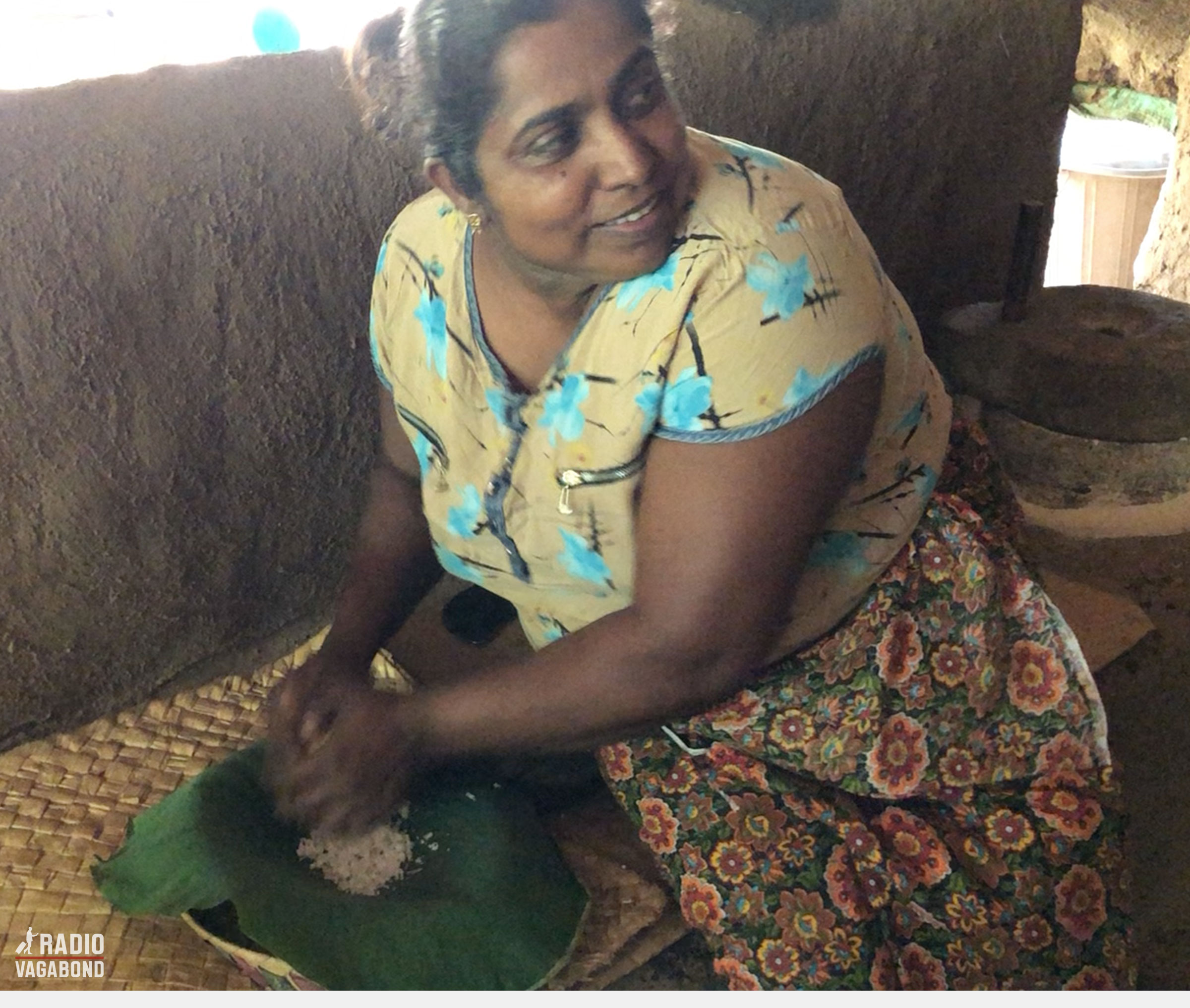 She starts grinding the inside of the coconut.